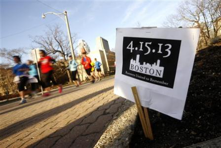 Runners participate in a memorial run in tribute to the the victims of the Boston Marathon bombing in Toronto